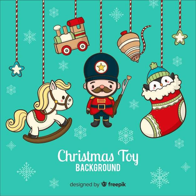 Hand getrokken kerstmis speelgoed achtergrond Gratis Vector