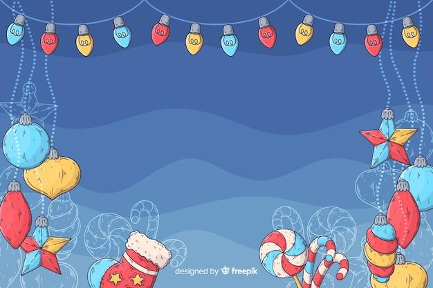 Hand getrokken ontwerp van kerstmis als achtergrond Gratis Vector