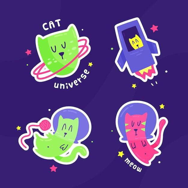 Hand getrokken sticker katten in de ruimte Gratis Vector