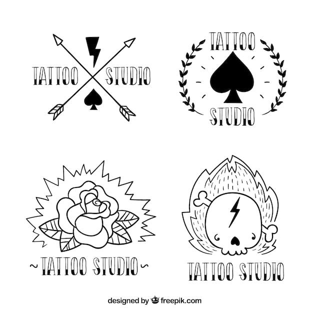 Hand getrokken tatoeage studio logo's, zwart en wit Gratis Vector