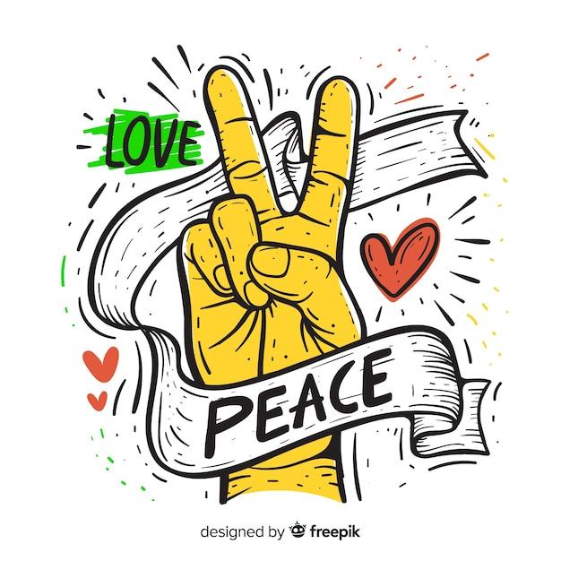 Hand getrokken vredesteken hand Gratis Vector