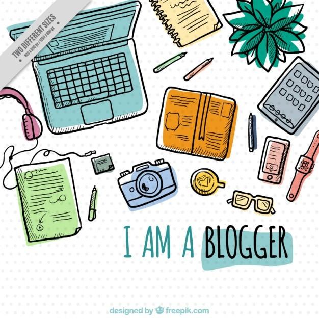 Hand getrokken werkplek van een blogger achtergrond Gratis Vector