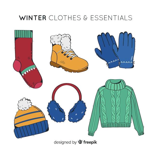 Hand getrokken winterkleren en essentials Gratis Vector