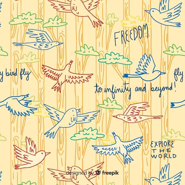 Hand getrokken woorden en vliegende vogels patroon Gratis Vector
