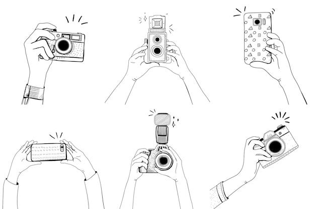 Hand met camera ingesteld Gratis Vector