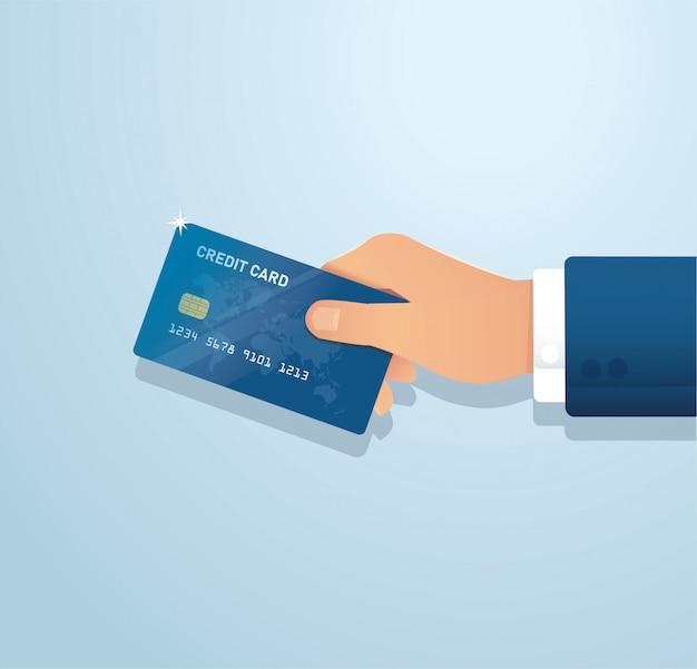 Hand met creditcard Premium Vector