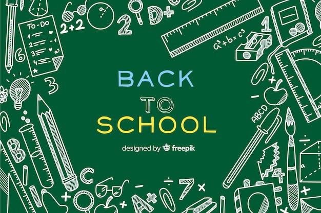 Hand terug naar school achtergrond getekend Gratis Vector