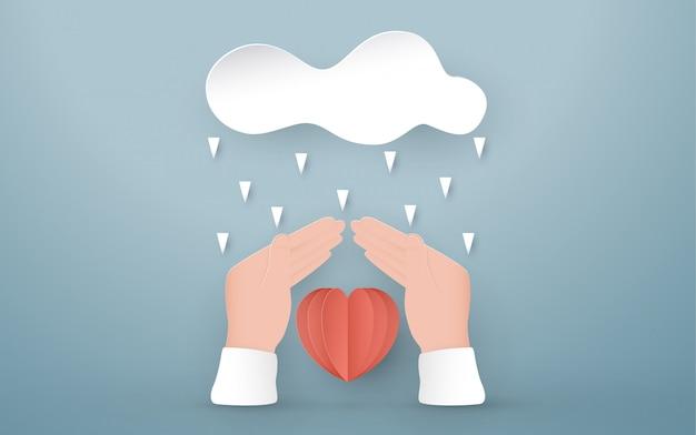 Handen beschermen het rode hart. Premium Vector