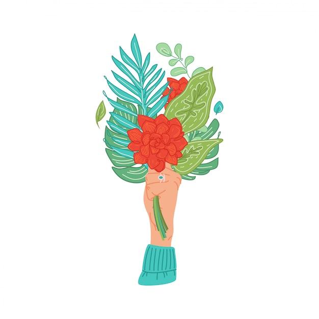 Handen met boeket trossen bloeiende bloemen, tropische bladeren. vrouwelijke hand met bloemen. bloemen decoratief ontwerpelement dat op wit wordt geïsoleerd Premium Vector