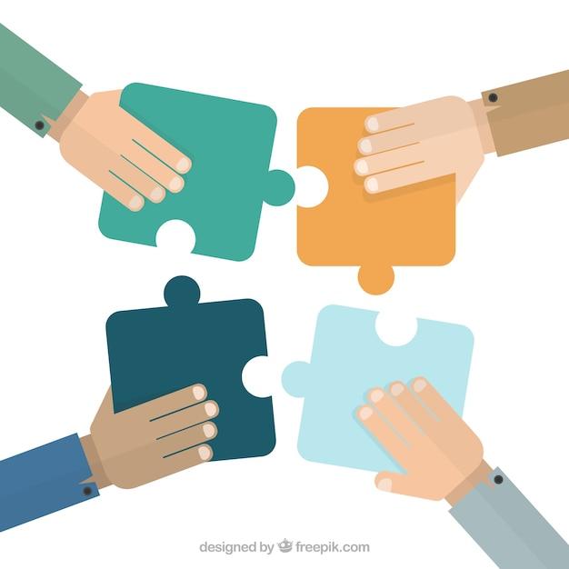 Handen zetten puzzelstukjes Gratis Vector