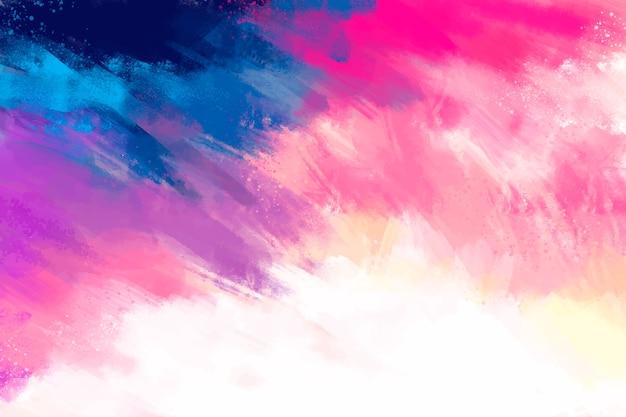 Handgeschilderde achtergrond in kleurovergang roze Gratis Vector