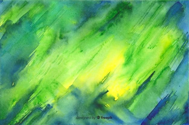 Handgeschilderde kleurrijke aquarel achtergrond Gratis Vector