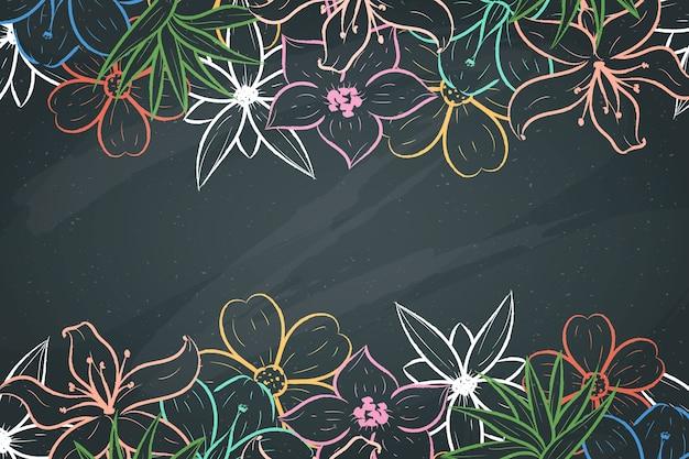 Handgetekende bloemen op blackboard achtergrond Gratis Vector