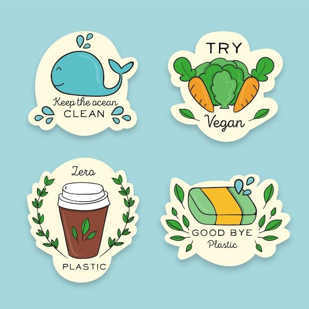 Handgetekende ecologie badges concept Gratis Vector