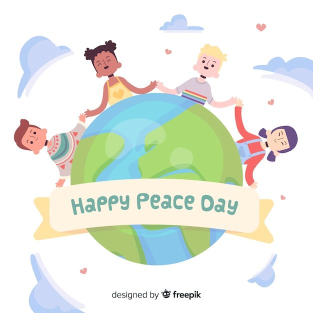 Handgetekende kinderen hand in hand voor vredesdag Gratis Vector