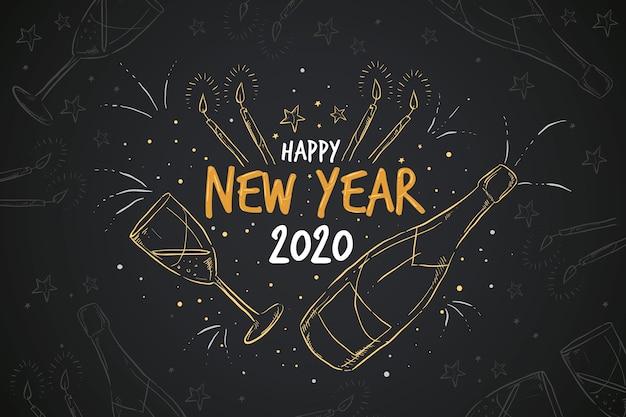 Handgetekende nieuwjaar achtergrond Gratis Vector