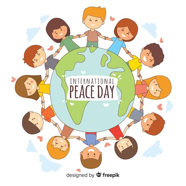 Handgetekende vredesdag kinderen hand in hand Gratis Vector