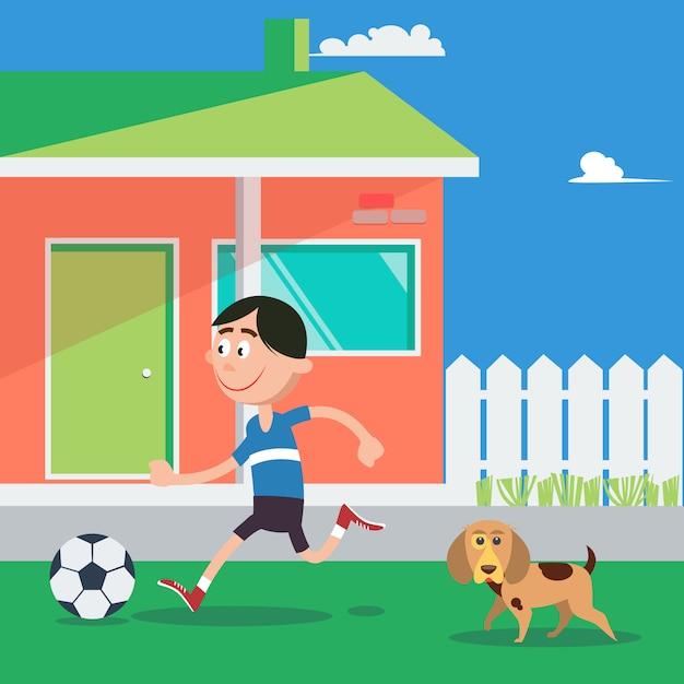 Happy boy voetballen met hond. Premium Vector