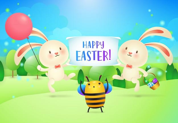 Happy easter letters op banner gehouden door twee konijnen en bijen Gratis Vector