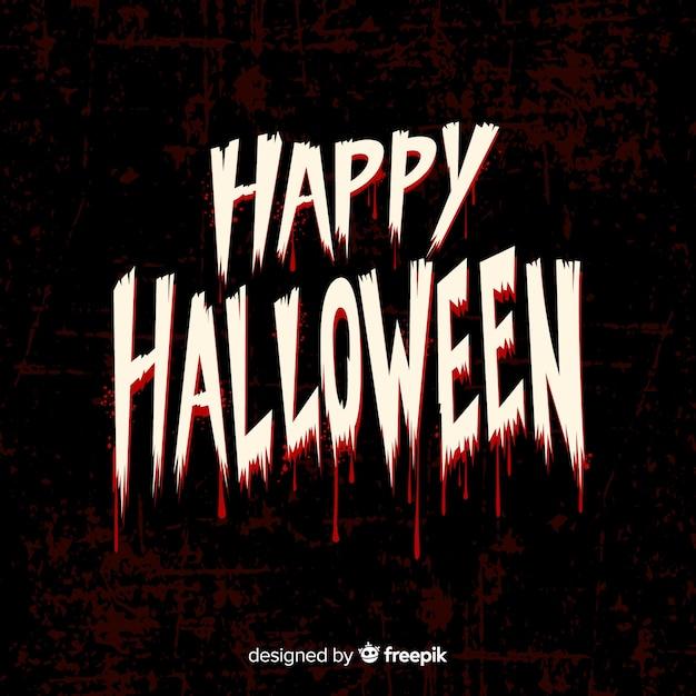 Happy halloween belettering lettertype met bloed Gratis Vector