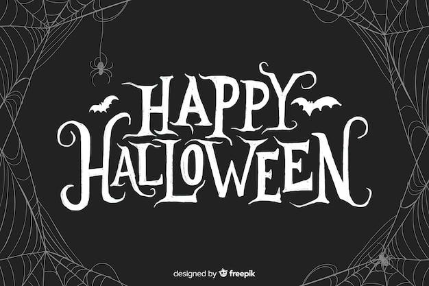 Happy halloween belettering met spiderweb Gratis Vector