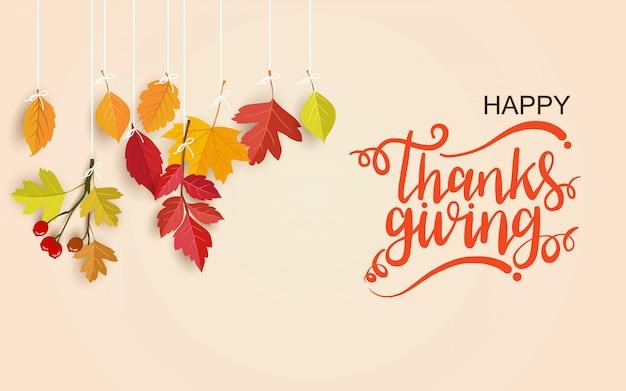 Happy thanksgiving day wenskaart met belettering en hangende bladeren Premium Vector