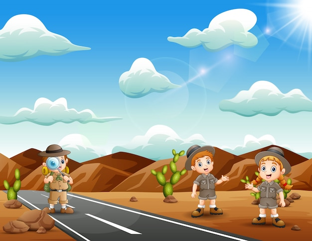 Happy zookeepers verkend in de woestijn Premium Vector