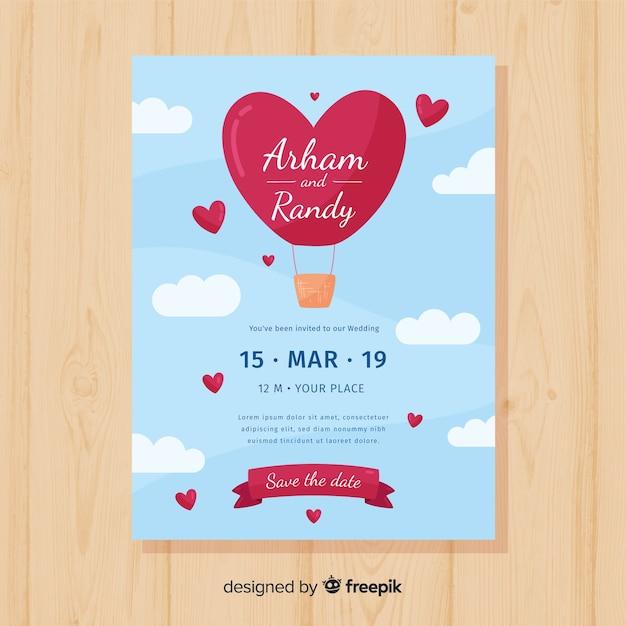 Hart hete lucht ballon bruiloft uitnodiging sjabloon Gratis Vector