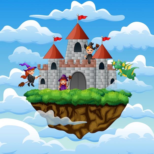 Heksen en draak vlogen rond het kasteel op de wolken Premium Vector