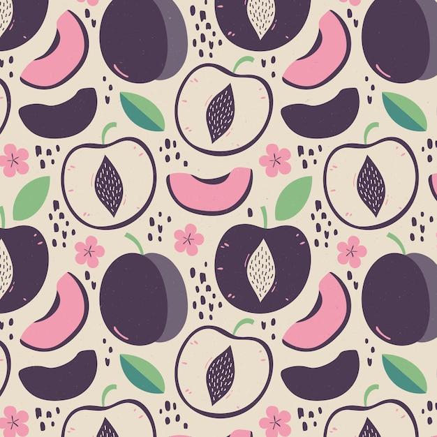 Helften van pruimfruit en bloemen met bladerenpatroon Gratis Vector