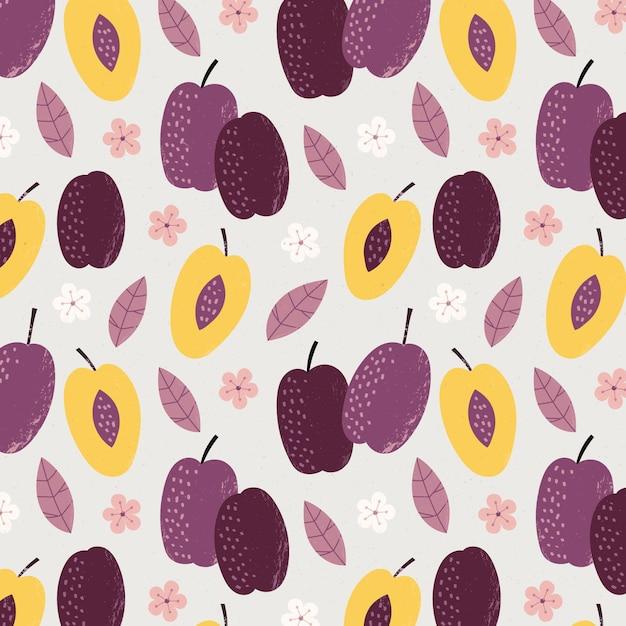 Helften van pruimfruit en bloemenpatroon Gratis Vector