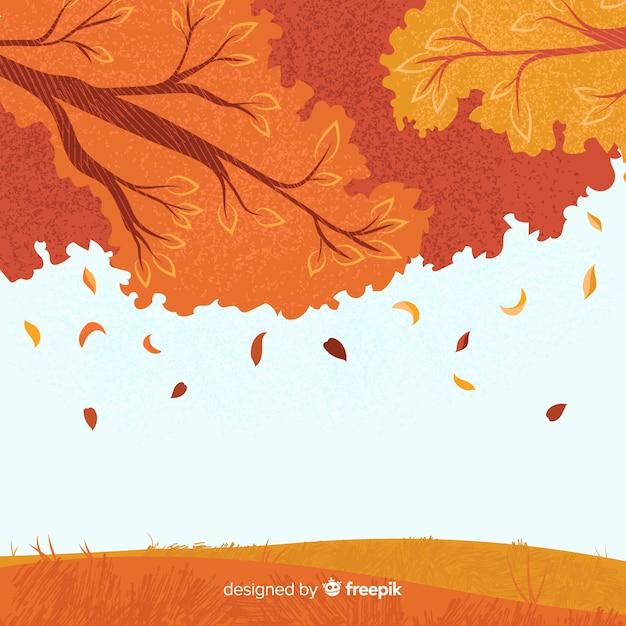 Herfst achtergrond hand getrokken stijl Gratis Vector