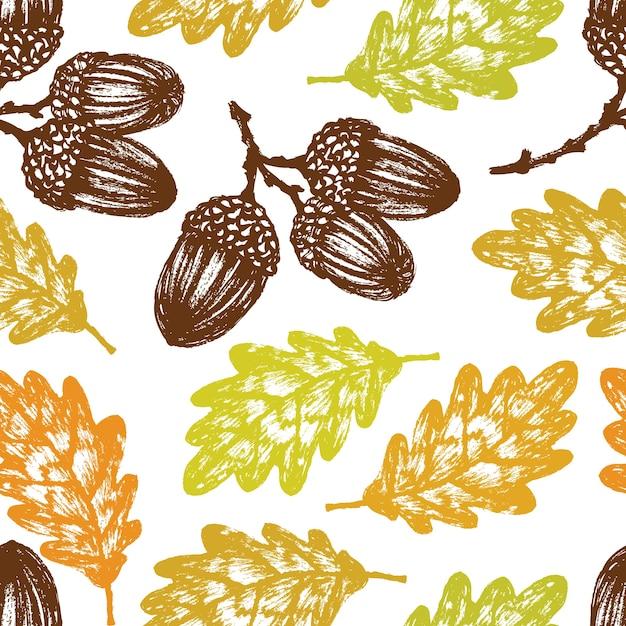 Herfst eiken bladeren en eikelen patroon Gratis Vector