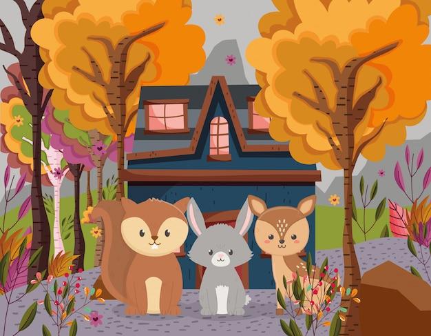 Herfst illustratie van schattige herten konijn en eekhoorn cottage bos Premium Vector