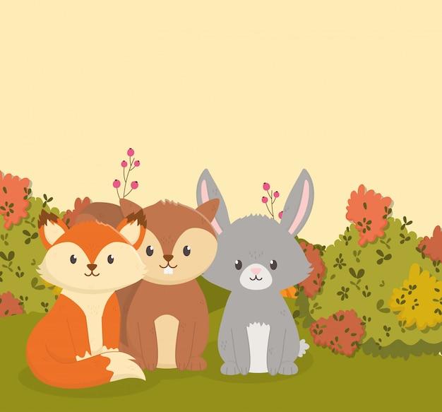 Herfst illustratie van schattige vos konijn en eekhoorn bladeren Premium Vector