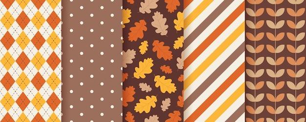 Herfst patroon seizoensgebonden texturen instellen. Premium Vector