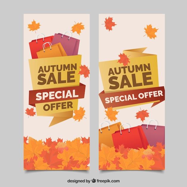 Herfstbanners met boodschappentassen en bladeren Gratis Vector