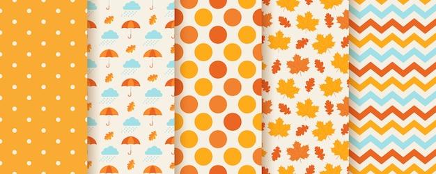 Herfstpatronen met herfstbladeren, polka dot, paraplu en zigzag. seizoensgebonden geometrische prints. Premium Vector
