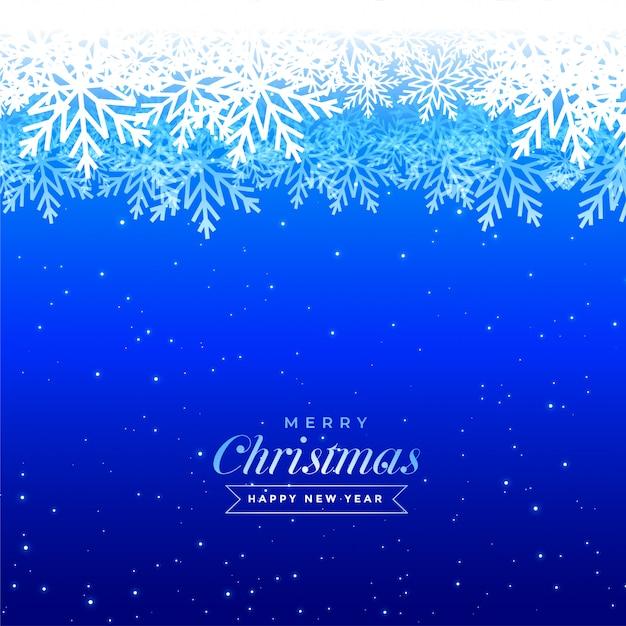 Het blauwe ontwerp van de de sneeuwvlokken mooie groet van de kerstmiswinter Gratis Vector