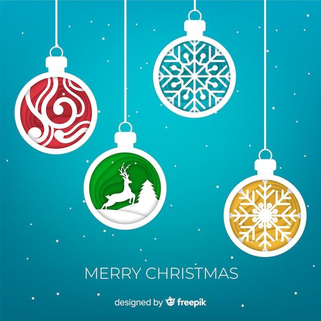 Het document siert de achtergrond van kerstmisballen Gratis Vector