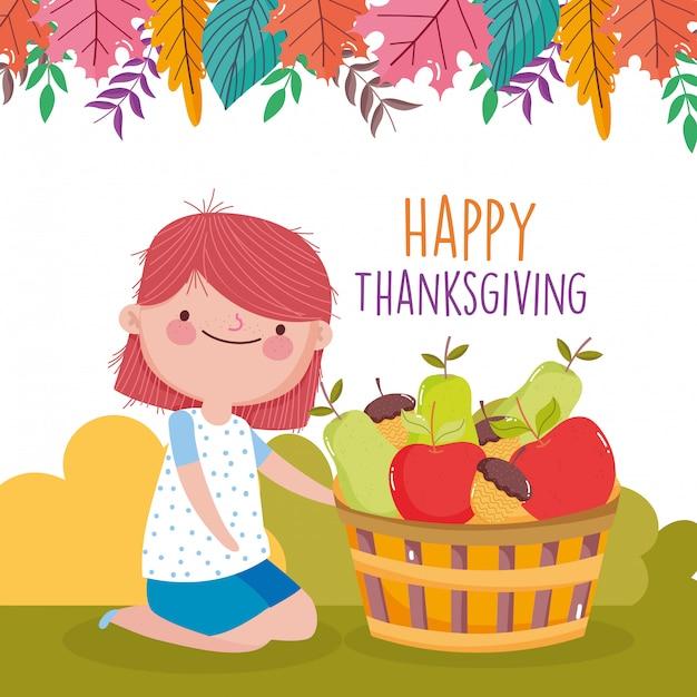 Het gelukkige leuke meisje van de dankzeggingsviering met mand gevulde vruchten in het park Premium Vector