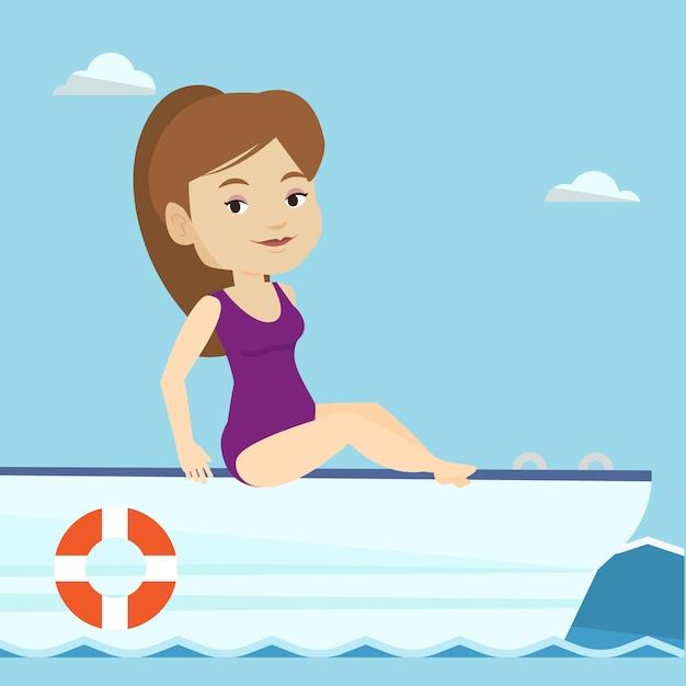 Het jonge gelukkige vrouw looien op zeilboot. Premium Vector