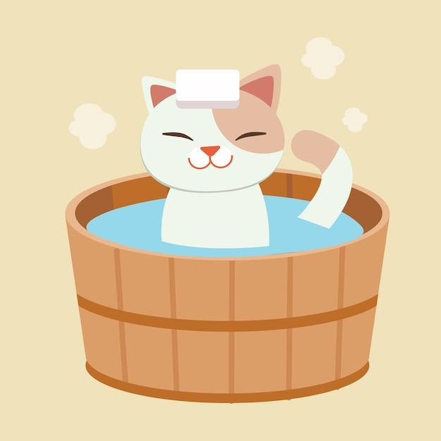 Het karakter van schattige kat neemt een japans warmwaterbronbad. de kat neemt een onsen. het ziet er gelukkig en ontspannend uit. kat baden in een vat in een bad buiten. Premium Vector
