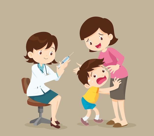 Het kind is bang voor injectie Premium Vector