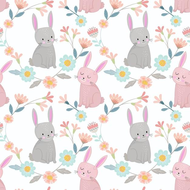 Het leuke konijntje in bloemen tuiniert het naadloze textieltextuur van het patroonpatroon. Premium Vector