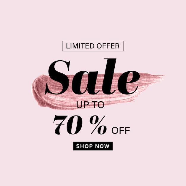 Het malplaatje van de verkoopbanner met roze gouden geschilderde borstel en verkooptekst op roze achtergrond Premium Vector