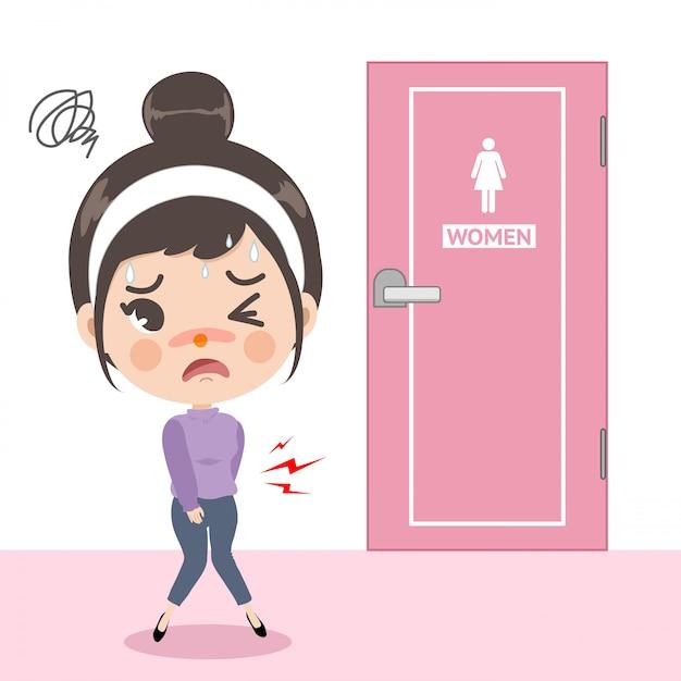 Het meisje voelde buikpijn in de voorkant van het toilet, maar dat is druk bezig haar te laten lijden omdat ze meteen het toilet wilde gebruiken. Premium Vector