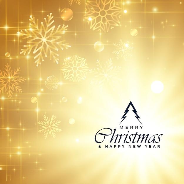 Het mooie vrolijke groet van kerstmis gouden fonkelingen Gratis Vector