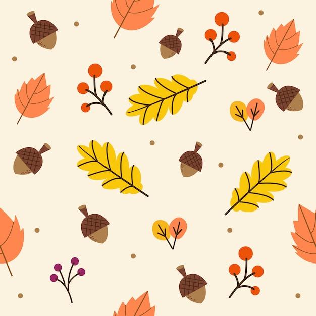 Het naadloze patroon van de herfst of herfstbladeren op de gele achtergrond. Premium Vector