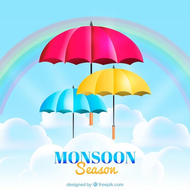 Het seizoenachtergrond van de moesson met kleurrijke paraplu's Gratis Vector
